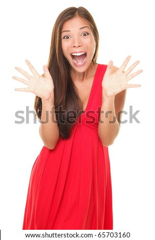 Surprise! Portrait of excited surprised young woman in red dress.  Happy cheerful Asian / Caucasian female model isolated on white background.