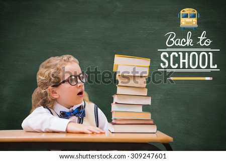 Surprise pupil looking at books against green chalkboard