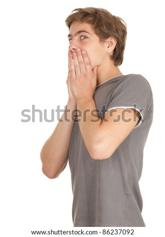 surprise - shock, frightened young man with hands on mouth - stock photo