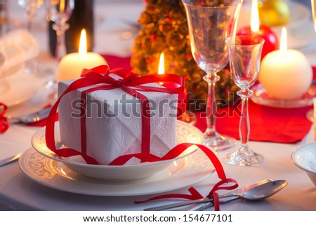 Surprise waiting  for the family on a Christmas table - stock photo