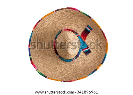 Surprise - what is hidden under the wide brim of the traditional sombrero hat, symbolic of Mexico, travel and tourism, overhead view isolated on white - stock photo