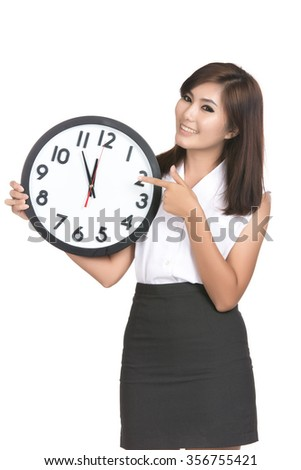Surprise young asian woman looking at alarm clock with blank copy space,Closeup portrait of beautiful Asian woman,Thai girl,Positive human emotion facial expression,isolated on white background - stock photo