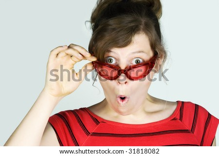 Surprise! Young woman looking amazed. - stock photo
