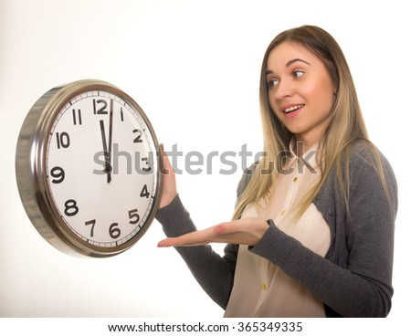 Surprise young woman looking at alarm clock with blank copy space, closeup portrait of beautiful europian woman, positive human emotion facial expression