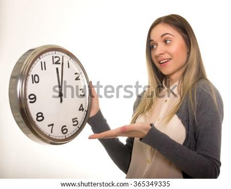 Surprise young woman looking at alarm clock with blank copy space, closeup portrait of beautiful europian woman, positive human emotion facial expression - stock photo
