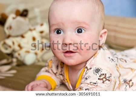Surprised adorable little boy portrait. Horizontal image - stock photo