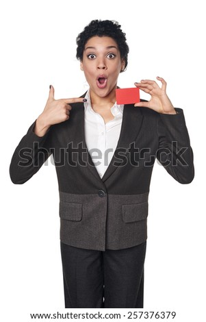 Surprised african american business woman showing blank credit card and pointing at it, over white background. Excited businesswoman with opened mouth. - stock photo