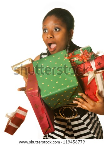 Surprised african girl dropping her christmas presents - stock photo