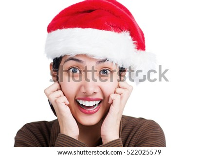 Surprised and excited lady wearing a Santa hat. Isolated in white background.