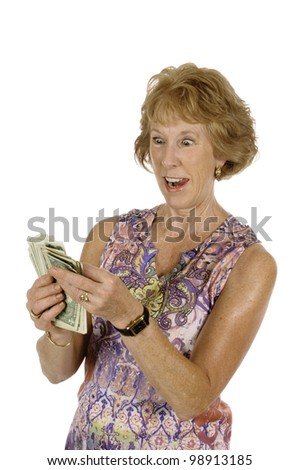 surprised and happy middle-aged woman after winning lottery counting money, isolated on white - stock photo