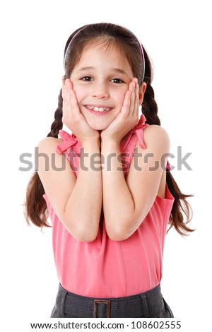 Surprised and smiling little girl, isolated on white - stock photo