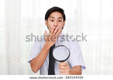 Surprised Asian businessman - stock photo