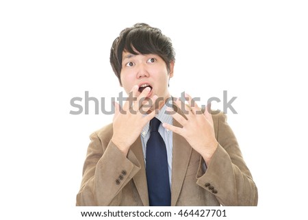 Surprised Asian businessman