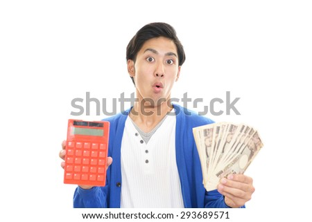 Surprised Asian man - stock photo