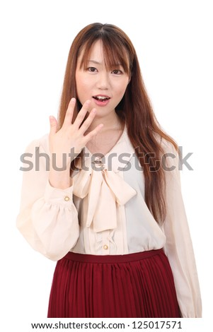 Surprised asian woman isolated on white background - stock photo