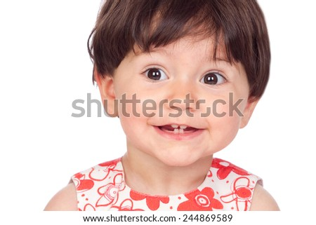 Surprised baby girl with only four teeth isolated on a white background - stock photo