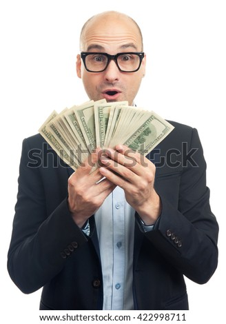 Surprised bald man holding a lot of money. Isolated over white