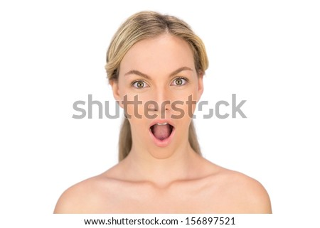 Surprised bare blonde posing on white background - stock photo