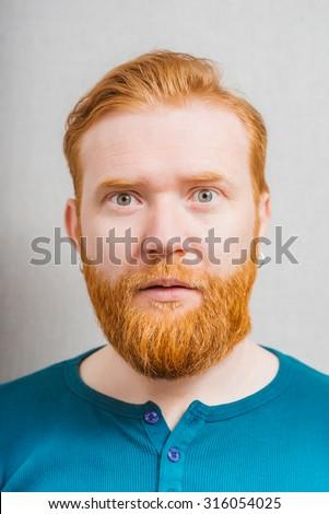 Surprised bearded man - stock photo