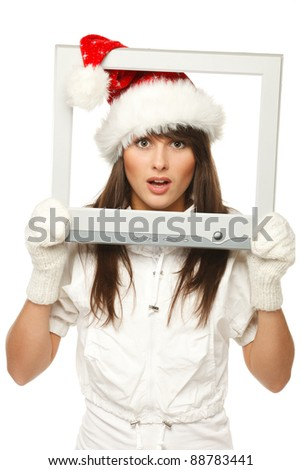 Surprised beautiful girl in Santa hat broadcasting Christmas news through TV / computer screen, isolated on white background. Christmas news. - stock photo