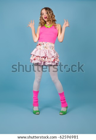 Surprised blond woman in pink - stock photo