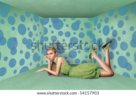 surprised blonde in blue dress isolated on white background - stock photo