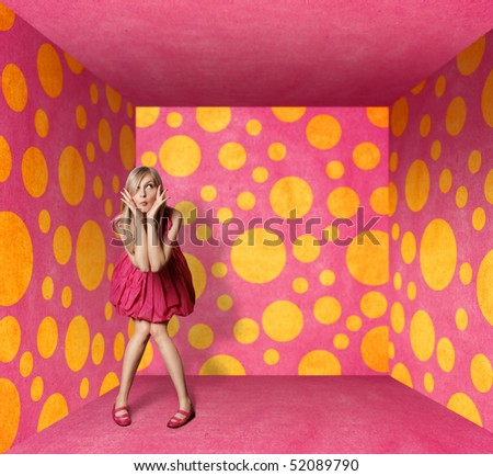 surprised blonde in pink dress in pink room - stock photo