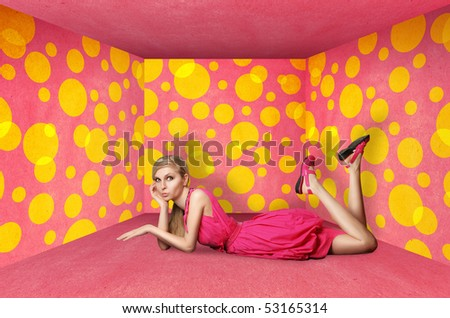 surprised blonde in pink dress isolated on white background - stock photo
