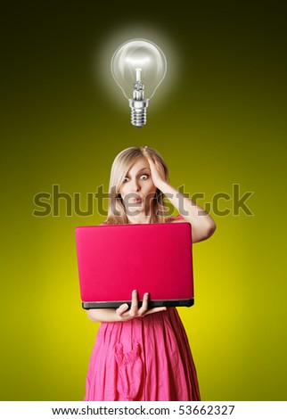 surprised blonde in pink dress with laptop and bulb - stock photo