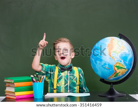 Surprised boy in classroom - stock photo