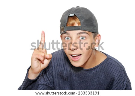 surprised boy in the cap with finger up