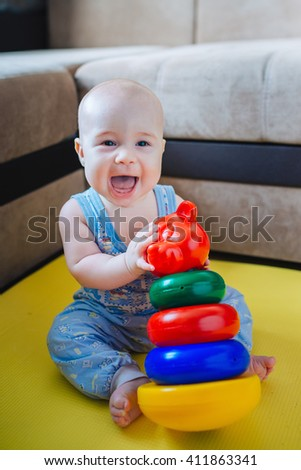Surprised boy playing with pyramid - stock photo