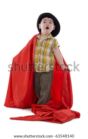 surprised boy with hat and red silk fabric looking up, isolated on white - stock photo