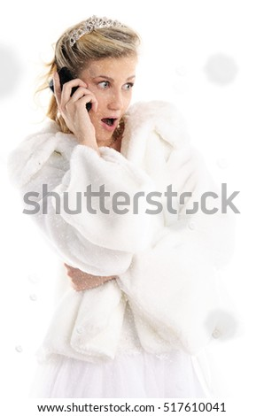 Surprised bride with mobile phone and snow isolated on white