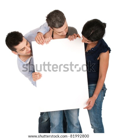 surprised brother and sisters looking at a banner ad, isolated on white background - stock photo