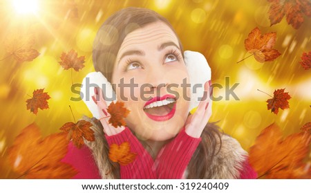 Surprised brunette in winter clothes against park