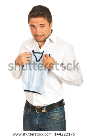 Surprised business man holding shrunk wool vest isolated on white background