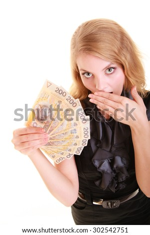 Surprised business woman holding polish currency money banknote and covering her mouth with hand. Finance savings concept.