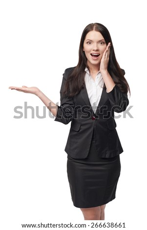 Surprised business woman showing open hand palm with copy space for product or text - stock photo