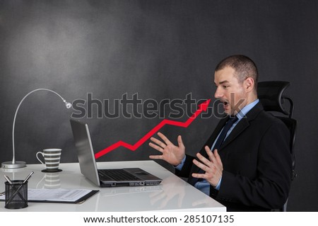 Surprised businessman. Growth arrow chart business of laptop - stock photo