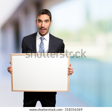 Surprised businessman holding a name card