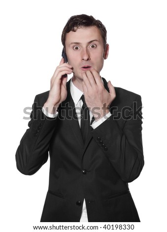 surprised businessman in a black suit with a mobile phone - stock photo