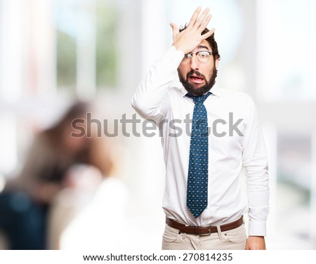 surprised businessman. indoor background - stock photo
