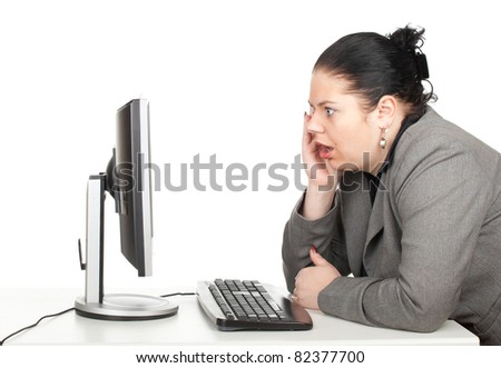 surprised businesswoman in grey suit with computer