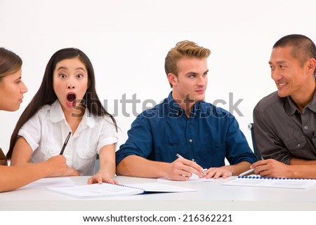 Surprised businesswoman with her colleagues workplace - stock photo