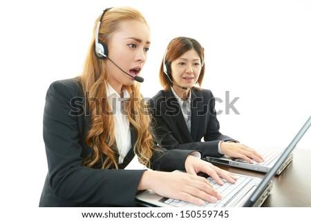 Surprised call center operators - stock photo