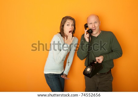 Surprised Caucasian couple on a telephone call