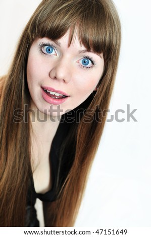 surprised cheerful girl with long beautiful hair - stock photo