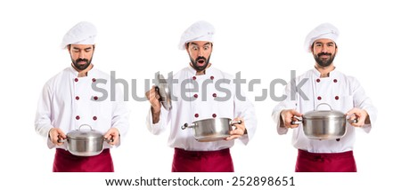 Surprised chef holding a pot - stock photo