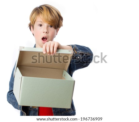 Surprised child opening a box - stock photo